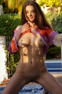 Veronika Glam perfectly curved brunette teasing on the terrace