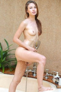 Superb brunette Hilary C poses naked showing us what she actually has