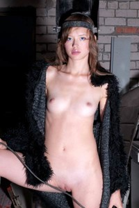 Sweet and petite babe Kitana A exposes her fresh young body as she poses naked in the workshop