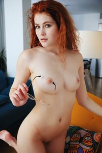 A flirty and playful Adel C exhibits her fresh pale body with perky tits