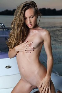 Astonishing babe poses naked on the boat baring her magnificent body