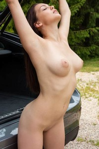Brunette goddess with perfect body washes her car and looks incredibly sexy