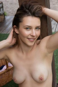 Brunette sweetheart Dominika Jule exposes her fresh and young body outdoor