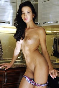 Adorable and playful shows off her curvy body in the kitchen