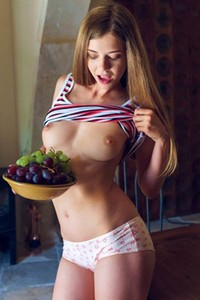 Blossoming young angel Kay J flaunts her delightful naked body on the kitchen table