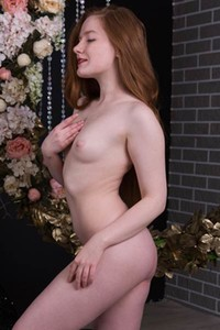 Fantastic redhead beauty strips her lace dress baring her pale breasts and hairy pussy
