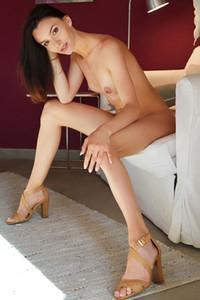 Long legged brunette Adel Morel poses naked on high heels showing us her amazing skinny body