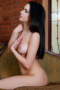 Dark haired angel gently strips her black dress baring her perfect body