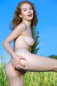 Lovely blonde angel sensually poses in nature showing us her smooth pale body