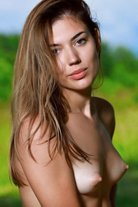 Gorgeous tanned beauty Maddison sensually poses naked in nature