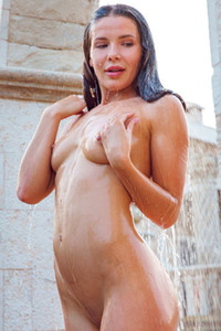 Stunning brunette Lika Dolce puts down her bikini and presents us her body shapes in solo pool time