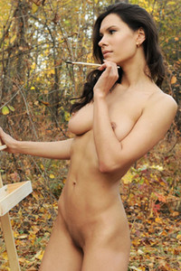 Painter with just perfect natural attributes having fun totally naked outdoors in the woods