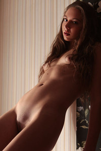 Sweet but foxy slender beauty expose her tight body on the sofa