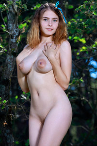 Fantastic redhead doll strips naked in nature baring her gorgeous big boobs