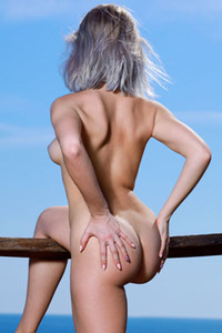 Mesmerizing young beauty Libby enjoy getting naked on the sea dock
