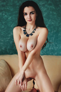 Smoking hot Maible shows off her magnificent big breasts and petite body on the sofa