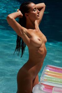 Meg skinny brunette is in her swimming pool enjoying her day off totally naked