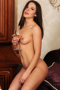 Mesmerizing brunette doll Lika Dolce sensually strips her white dress and shows us her perfect body