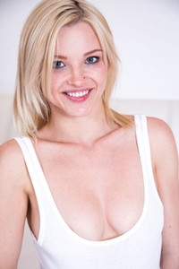 Stunning blonde Zazie presents us her amazing body while she is posing seductively on the bed