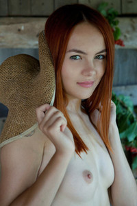Young and sweet redhead babe Shaya slowly takes off her dress and teases with the beauty of her body