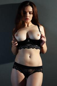 Brunette goddess strips her underwear baring her divine body and amazing big breasts