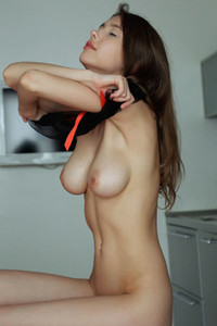 Mesmerizing young doll Mila Azul presents her luscious young body on the red sofa
