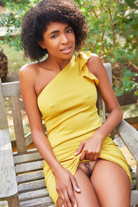Sultry ebony honey drops down her yellow dress exposing her amazing ass