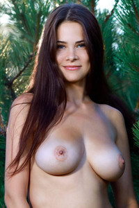 Tempting brunette beauty flaunts her beautiful pale body in nature