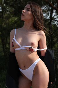 Extremely hot brunette vixen strips naked and seductively poses on the beach