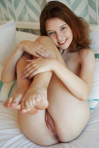 Astonishing petite babe takes off her blue gown and sprawls her pale body on the bed