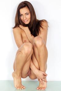 Alluring brunette goddess strips her lingerie and uninhibitedly flaunts her perfect body