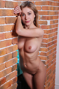 Alluring young dame shows off her divine naked body in front of the camera